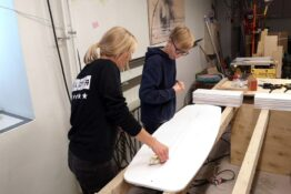 Surfing school students building their iceboards